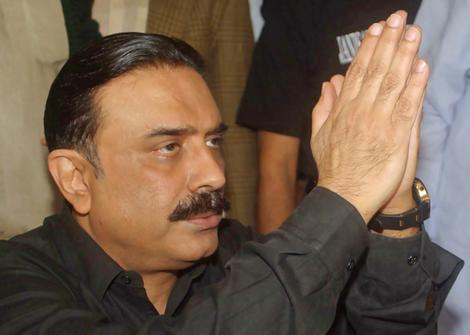 Husband of slain Pakistani opposition leader Bhutto gestures during a condolence meeting in Naudero